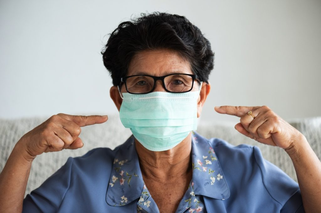 An at-risk patient wearing a mask at the dentist