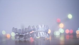 Invisalign in Newton with Christmas lights in the background