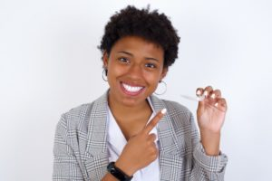 woman happy with her Invisalign aligners