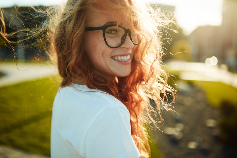young woman smiling outside